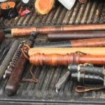 Suspicious vehicle observed across from the Queen Anne's County High School leads to seizure of numerous weapons.